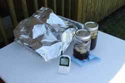 Close up of themometer, iced tea and foil pan