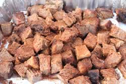 Rub sprinkled on brisket cubes