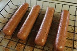 Hotdogs coated with rub - not spiral cut