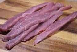 Pork tenderloin cut into 1/4 inch strips