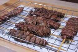 Pork Tenderoin on sticks in the Bradley rack