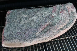 Brisket placed directly on grate of smoker