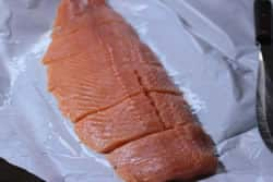 Cut salmon filet into pieces
