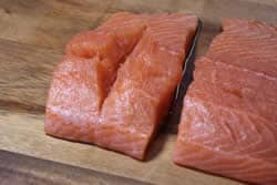Cut groove into salmon pieces