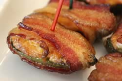 Cream cheese stuffed jalapenos wrapped in bacon
