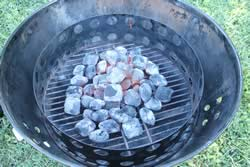charcoal poured into smoker