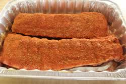 Mustard and rub on top side of ribs