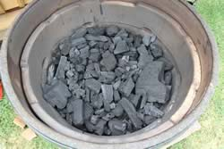 Pour the fire bowl full of lump charcoal