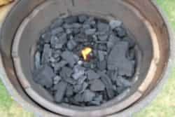 Place fire starter in center of charcoal