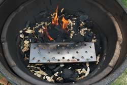 Chip box placed on top of coals