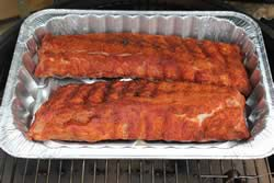 Ribs wrapped in foil or foil pan
