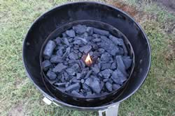 Add charcoal and a piece of firestarter. LIght the firestarter
