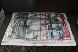 Oil drizzled on newspaper
