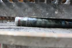 Paper roll placed under charcoal grate