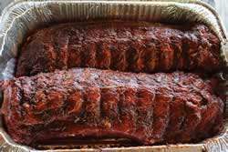 Rub added and massaged into the ribs