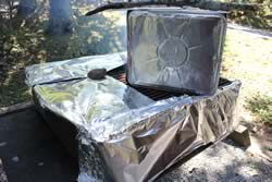 Foil around grill to direct the heat and smoke up through the box