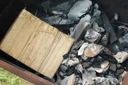 2 chimneys of lump charcoal into firebox