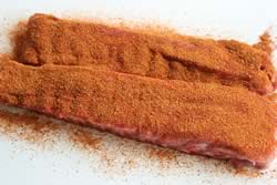 Top side of ribs covered in rub
