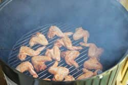 Chicken hot wings on bottom grate of WSM