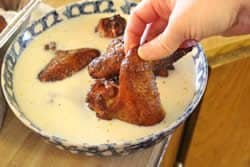 Chicken wings dipped in milk