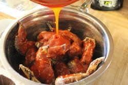 Pour sauce over wings