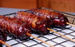 bacon wrapped hot links and sausages 1000x667