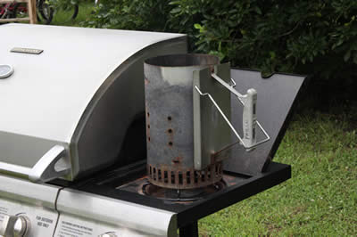 Chimney on side burner of grill